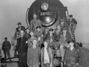 ES210-13-16 Dr. Syngman Rhee, President, ROK, and Mrs. Rhee (foreground) with Non-commissioned officers of the 62nd Engineets and train crew members in front of the first locomotive to cross the newly construdted railroad bridge spanning the Han River at