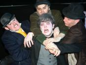 From Victoria College's production of Waiting For Godot. Lucky the slave gets tackled at the end of his famous monologue.