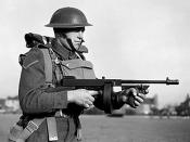 English: THE BRITISH ARMY IN THE UNITED KINGDOM 1939-45. A lance-corporal of the East Surrey Regiment poses with a 'Tommy gun', Chatham in Kent.