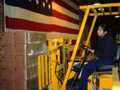 US Navy 030407-N-5821W-001 Storekeeper Seaman Estella Perez operates a forklift in order to weigh a pallet of Tastykake snacks