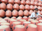 English: drinking water clay pot container. தமிழ்: களிமண்ணால் செய்யப்பட்ட குடிநீர் கொள்கலன்.