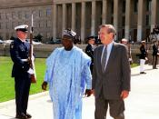 Secretary of Defense Donald H. Rumsfeld (right) escorts President Olusegun Obasanjo (left), of the Federal Republic of Nigeria, to the Pentagon parade field for a welcoming ceremony in his honor on May 10, 2001.