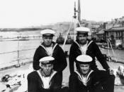English: Four crew members from British cruiser H.M.S. Dragon pose on the deck at the stern of the ship, possibly in Brisbane.