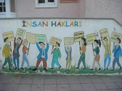 English: A mural describing human rights in Turkey outside of the public education building in Bayramic Turkey