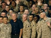 U.S. Service members gather around President George W. Bush during a visit to Al Asad Air Base, Iraq. Bush was joined by Secretary of Defense Robert M. Gates, Secretary of State Condolezza Rice, Chairman of the Joint Chiefs of Staff Gen. Peter Pace, U.S.
