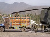 Pakistani soldiers load humanitarian relief supplies onto a U.S. CH-47D Chinook helicopter at Muzaffarabad, Pakistan, on Nov. 19, 2005.