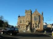 English: Camborne Library And Richard Trevithick Statue. Camborne Library and statue of Richard Trevithick who invented the steam locomotive The Puffing Devil