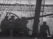 English: Royal Navy gunner covering the troops retreat at Dunkirk (France, 1940). Screenhot taken from the 1943 United States Army propaganda film Divide and Conquer (Why We Fight #3) directed by Frank Capra and partially based on, news archives, animatio