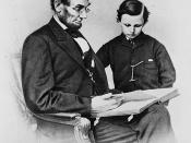 English: Abraham Lincoln and his son Tad looking at an album of photographs.