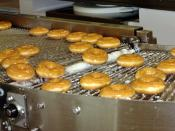 Krispy Kreme doughnuts being made at the Krispy Kreme restaurant at Kingsford Smith Airport, Sydney, Australia.