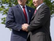 President George W. Bush of the United States and President Vladimir Putin of Russia, exchange handshakes Thursday, June 7, 2007, after their meeting at the G8 Summit in Heiligendamm, Germany.
