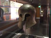 English: Corinthian helmet, This is an early Greek helmet, dating from around the 7th-5th century BC. This would have been the time when the polis system was forming in Greece. To be a citizen in a polis, you would have also been a soldier. So this was pr