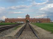 English: The main gate at the former Nazi death camp of Birkenau. Note that this is inside the camp looking back from the loading ramp to the