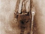 Billy the Kid (1860 – 1881). Image mirrored on vertical axis to correct widely-seen flopped tintype. Cartridge loading gate on Winchester Model 1873 lever action rifle is on the right side of the receiver.