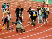 Cathy Freeman dodges the media scrum at the end of the 400m final.