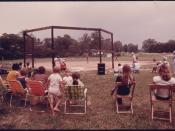 HELEN AND ROBERTSTOWN, GEORGIA AREA RESIDENTS WATCH A SLOW PITCH SOFTBALL GAME IN PROGRESS AT THE SAUTEE-NACOOCHEE... - NARA - 557780