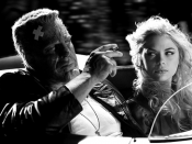 Mickey Rourke as Marv and Jaime King as Wendy in a scene from the Sin City movie.