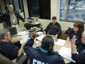 English: Atlanta, GA, March 24, 2008 -- Federal Emergency Management Agency (FEMA) Community Relations Team (CR) members meet at FEMA's Regional Office. FEMA CR teams will go from house to house in damaged areas to help in distributing information on