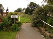 English: Trust There are no physical barriers apart from a stile leading to the public footpath which runs through the North Sea Camp Open Prison and alongside the fence to the left. The prisoners' quarters are to the right. You may even get a chance to s