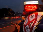 English: YOKOSUKA, Japan (Jan. 29, 2008) Vehicles move past a damaged vehicle displaying an anti-drinking and driving message at the main entrance to Fleet Activities Yokosuka. The display, placed by members of the base's