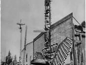 Totem poles in front of houses in Alert Bay, British Columbia in the 1900s.