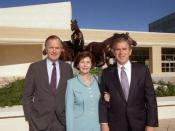 English: Former President Bush with son and daughter-in-law, Governor George W. and Laura Bush, at the George Bush Presidential Library Dedication in College Station, Texas