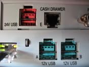 English: This is an image showing two types of powered USB ports (12v and 24v) as found on an NCR cash register.