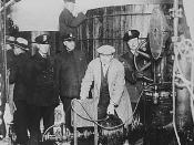 English: Detroit police inspecting equipment found in a clandestine underground brewery.