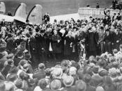 Neville Chamberlain showing the Anglo-German Declaration to a crowd at Heston Aerodrome on 30 September 1938.