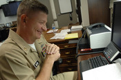 English: WASHINGTON (August 5, 2009) Master Chief Petty Officer of the Navy (MCPON) Rick West answers questions during a telephone interview with Navy wife and columnist Beth Wilson on Navy Homefront Talk! radio show. Navy Homefront Talk! is an internet t