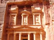 Petra is an extraordinary archaeological site in southwestern Jordan, lying on the slope of Mount Hor in a basin among the mountains which form the eastern flank of Arabah (Wadi Araba), the large valley running from the Dead Sea to the Gulf of Aqaba. The