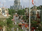 English: Main Street at the Magic Kingdom, Walt Disney World Resort, Lake Buena Vista, Florida, USA. The photo is taken presumably from the roof of the Walt Disney World Railroad, and the US Flag is in the foreground. In the background is the regal Cinder