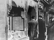 The aftermath of Kristallnacht, Jewish shops vandalized.
