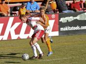 Stuart Holden of Houston Dynamo (right) vs Chris Leitch of Red Bull New York