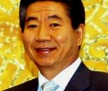 Cropped headshot of President Roh Moo-Hyun of South Korea. Original Description: U.S. Secretary of State Colin Powell and President of the Republic of Korea, Roh Moo-Hyun, at Cheong Wa Dae (The Blue House, the Korean President's official office and reside