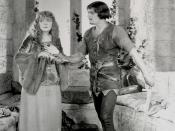 Douglas Fairbanks as Robin Hood giving Enid Bennett as Maid Marian (sic) a dagger; a screenshot from the 1922 United Artists film Robin Hood.