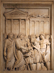 English: Emperor Marcus Aurelius (161-180 AD) and members of the Imperial family offer sacrifice in gratitude for success against Germanic tribes. In the backgrounds stands the Temple of Jupiter on the Capitolium (this is the only extant portrayal of this