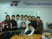 English: FSpace team members and F-1 nanosatellite