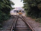 Looking towards the Dow Chemical factory on the short, now-lifted spur from the Bentinck Dock branch. 07013 can be seen behind the gates.