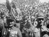 Hitler (left), standing behind Hermann Göring at a Nazi rally in Nuremberg (c. 1928)