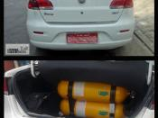 Picture taken at Sao Paulo, Brazil, of the new Fiat Siena Tetrafuel 1.4 model 2008 (two views edited with Photoshop, zoom in is the Tetrafuel logo -cut and paste from the same image-