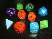 Dice for various games, especially for roleplaying games. Español: Dados en forma de poliedro regular (de 4, 6, 8, 10, 12, 20 y 100 caras) y el dado típico de 10 caras.