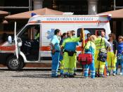 An ambulance and its crew in Modena, Italy.