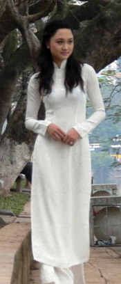 A young girl in áo dài by Hồ Gươm, Hanoi, Vietnam.