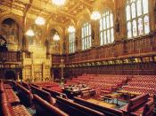 Photograph of the debating chamber of the House of Lords in the Palace of Westminster, London, looking south-west, towards the royal throne and the Woolsack.