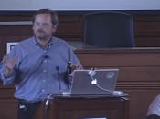 Screenshot of Lawrence Lessig presenting