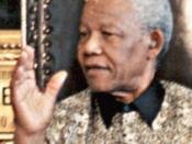 Português: Brasília - O presidente da África do Sul, Nelson Mandela, é recebido na capital federal.