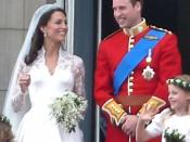 The British royal family on Buckingham Palace balcony after Prince William and Kate Middleton were married. Kate wears a wedding gown by Sarah Burton.