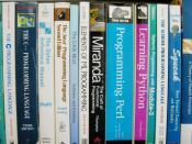English: A selection of programming language textbooks on a shelf. Levels and colors adjusted in the GIMP. Français : Une étagère en bois de houx naturel lacqué : Prgrammé en java pour avoir l'AIR réel. Ainsi que quelques livres
