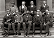 English: George Washington Carver (front row, center) poses with fellow staff members at the Tuskegee Institute (now known as Tuskegee University) located in the U.S. state of Alabama.